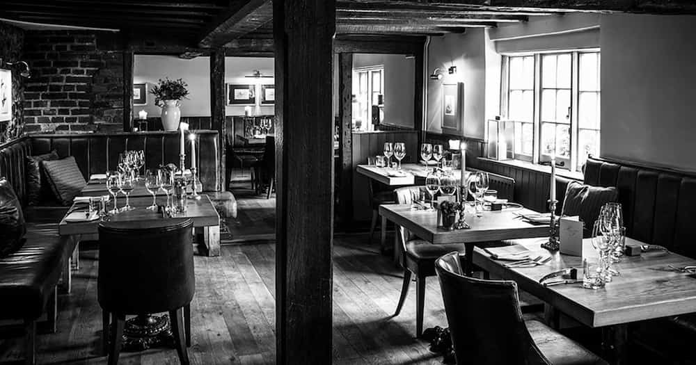 the hand and flowers wooden interior in black and white with dining tables and chairs