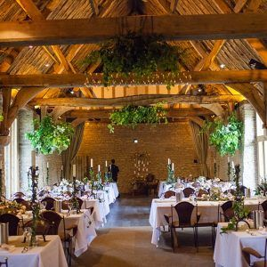 barn wedding reception beamed ceiling white table cloths