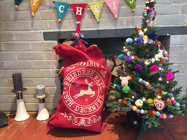 The kids tree and sack during the day - I LOVE the Merry Christmas sign you can just about see at the top