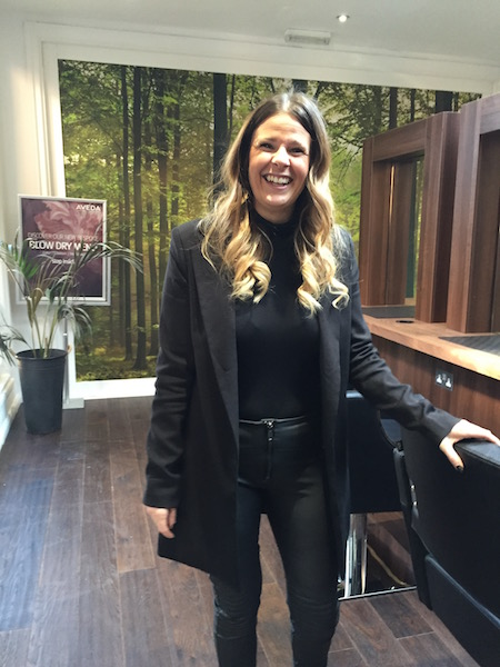 Elements owner Nicky, wearing head to toe black in her modern hair salon