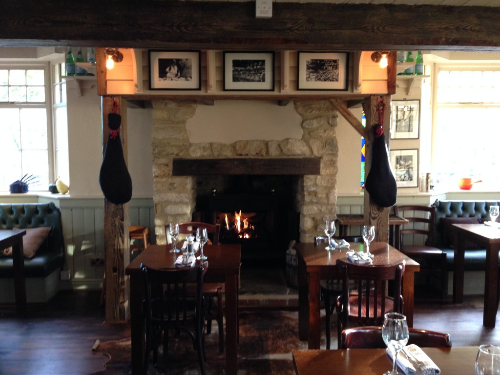 pub interior with roaring fire and exposed brickwork