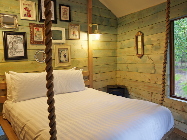 Cabin bedroom swinging bed panelled walls