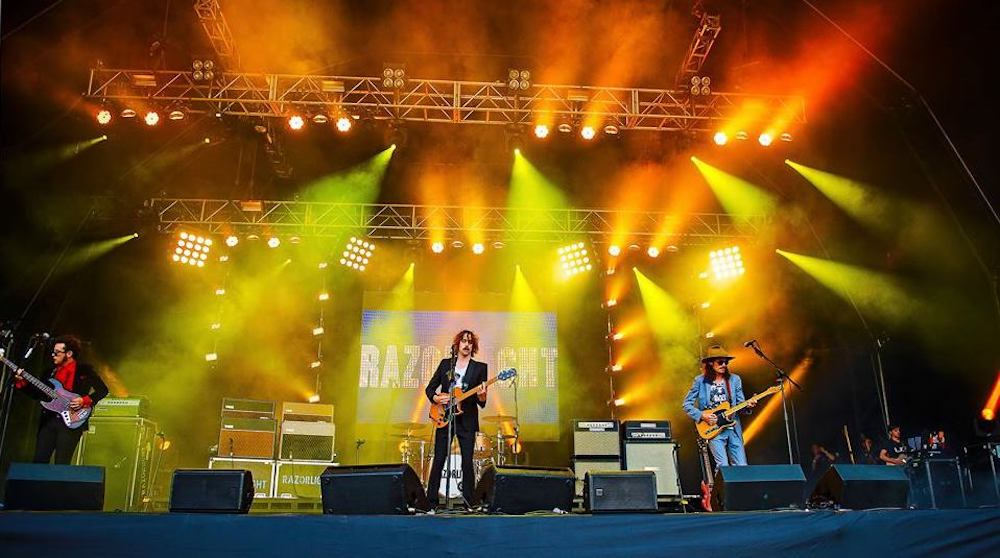razorlight on stage performing yellow orange lights