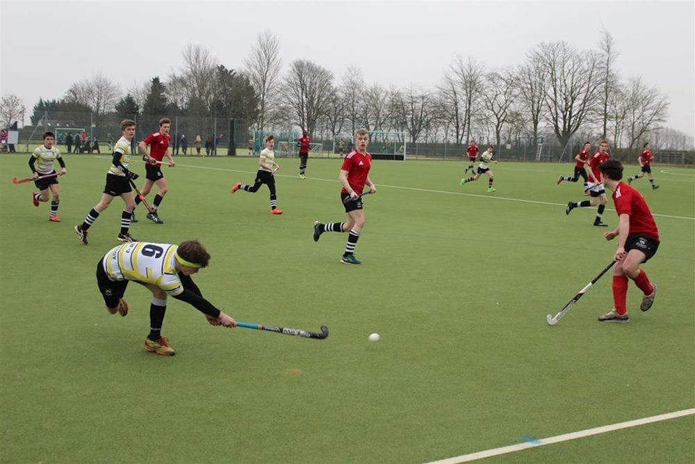 Boys hockey match on astroturf