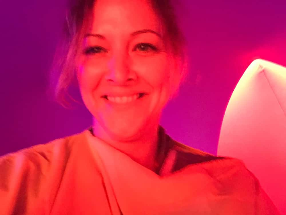 lady lit up red purple background