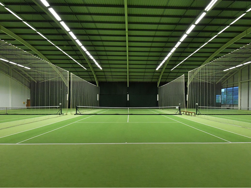 indoor green astro turf tennis courts