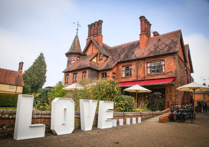 waddesdon five arrows hotel large orange brick building giant love letters
