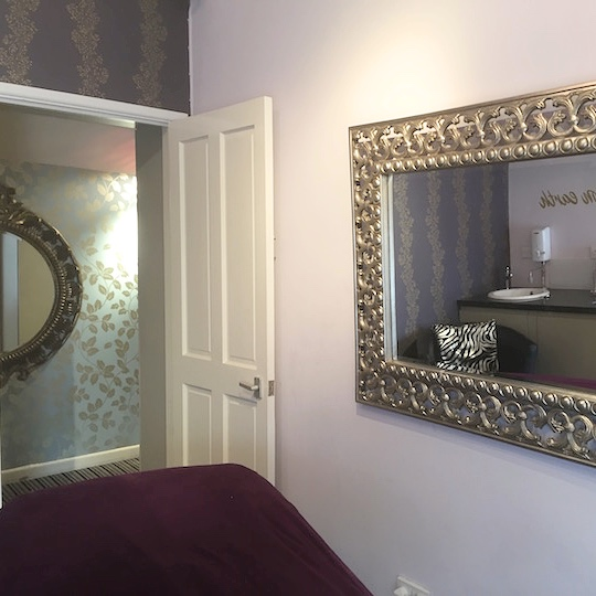 beauty treatment room gold ornate mirror on wall