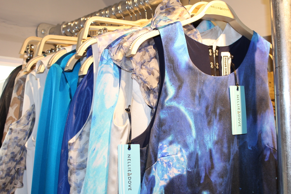 close up of blue dresses on hangers