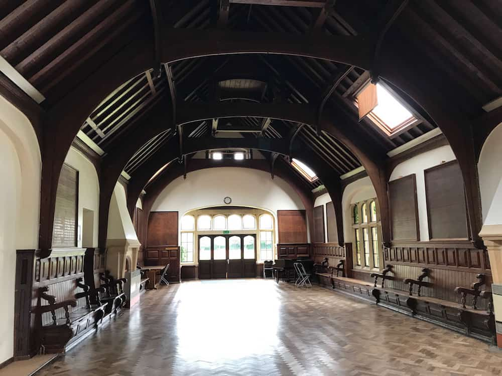 old school hall wooden floor wooden beam ceiling