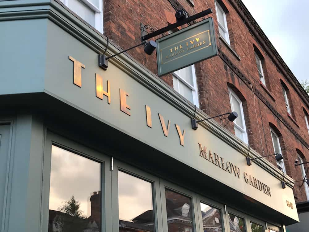 gold letters on green ivy Marlow garden restaurant sign