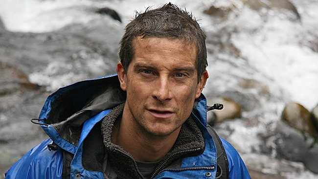 bear Grylls in rain jacket muddy face