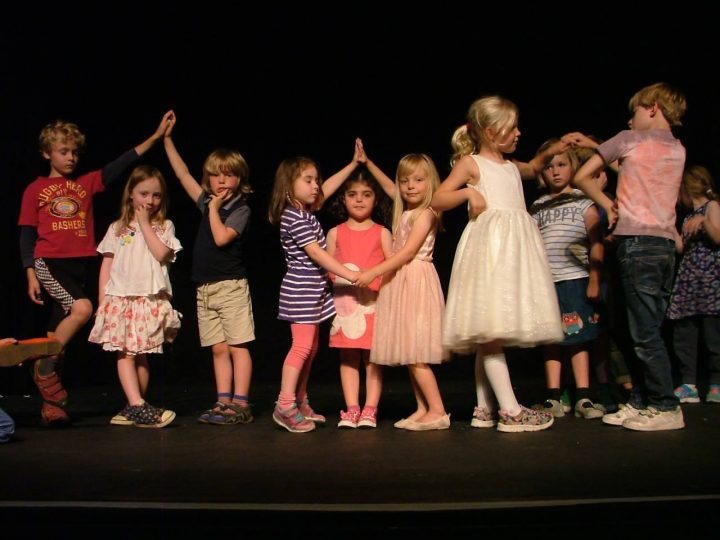 young children on stage dancing
