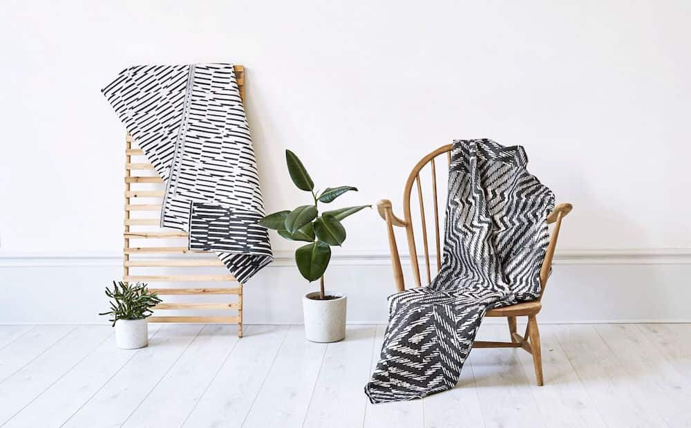 black and white throw over wooden chair