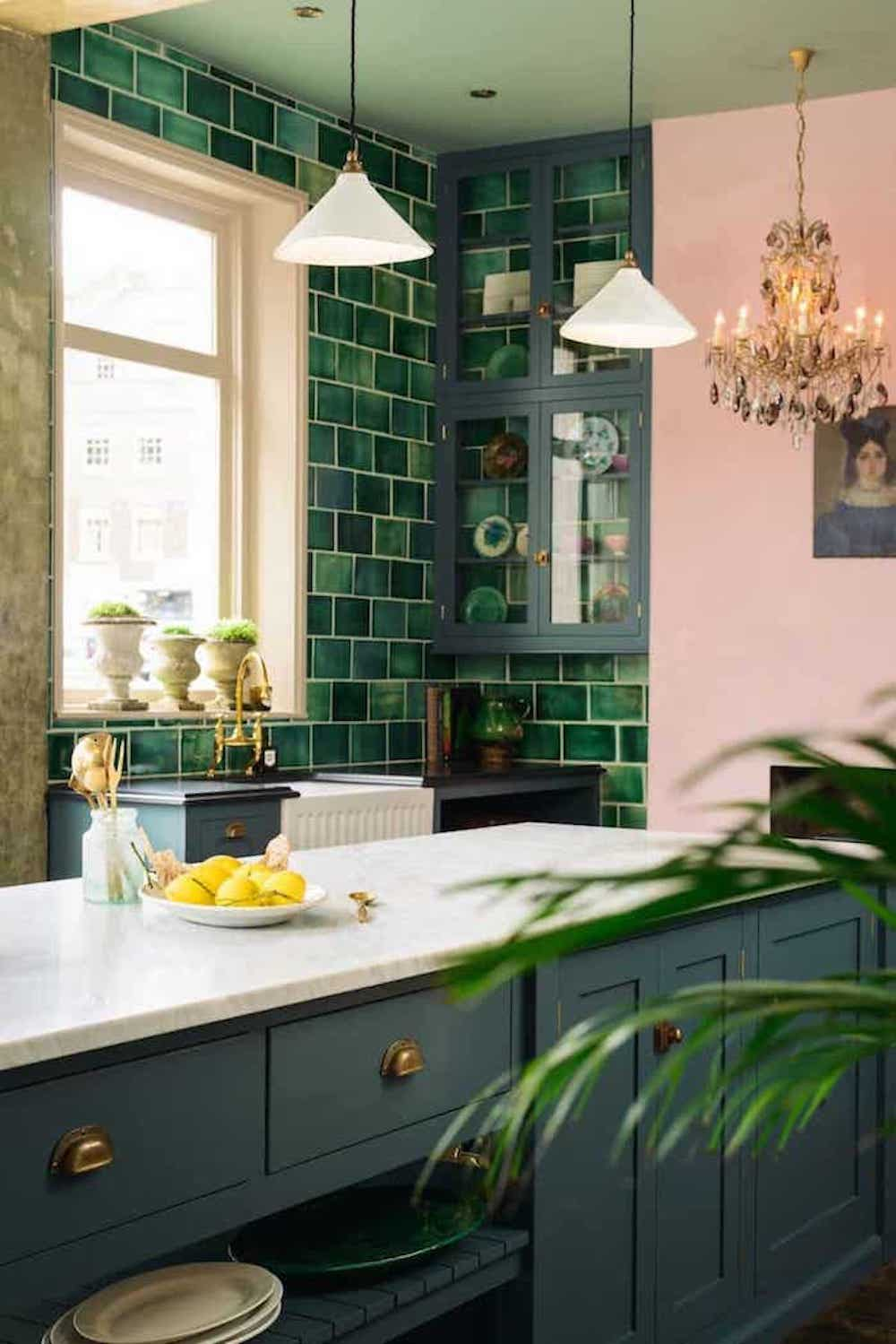 green tiled kitchen navy island