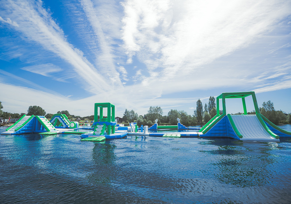 inflatable obstacle course on outdoor swimming pool