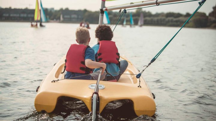 two young boys on yellow boat