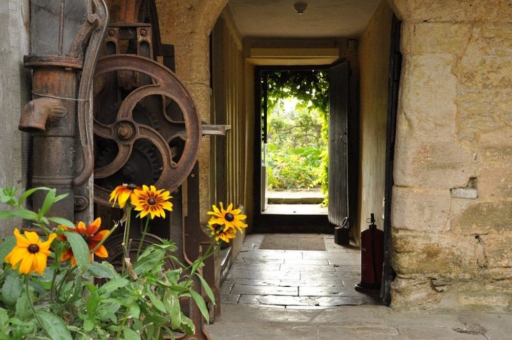 stone wall hall flagstone floor sunflowers