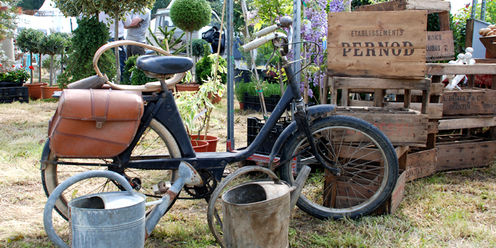old bike watering cans wooden crates