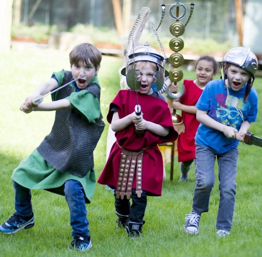 children dress as knights shouting