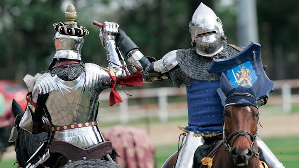 two silver knights horseback holding hands