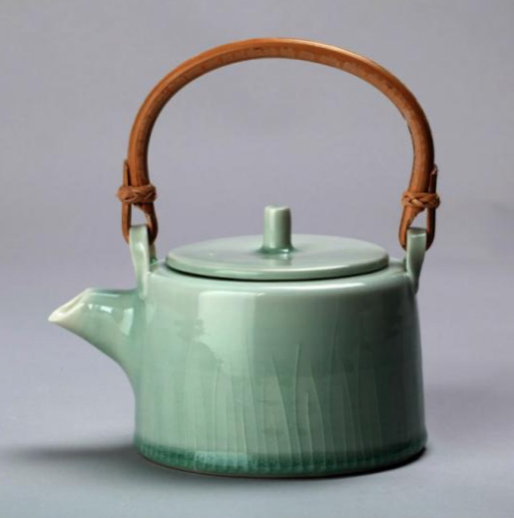 green porcelain kettle whicker handle