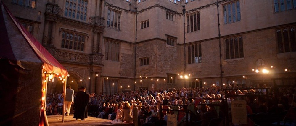 audience open air theatre fairy lights