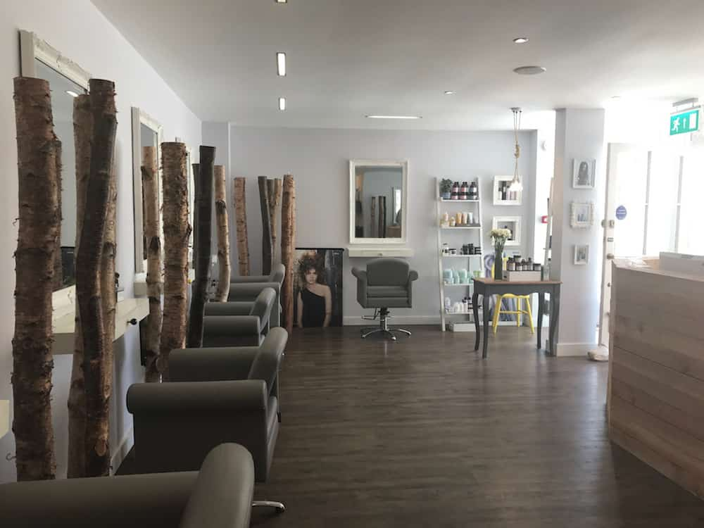 grey salon interior decorative tree beams