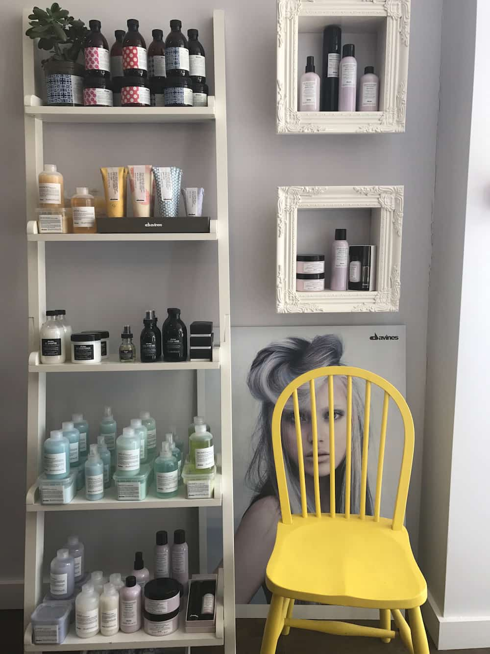 hair products on white ladder bright yellow chair
