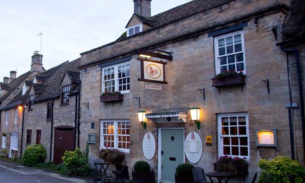 Cotswold Pub lights on early evening
