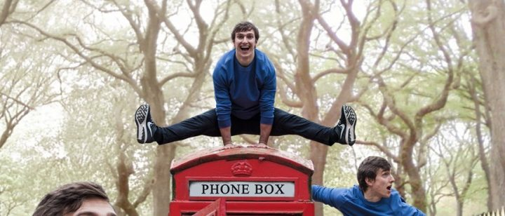 man jumping over telephone box