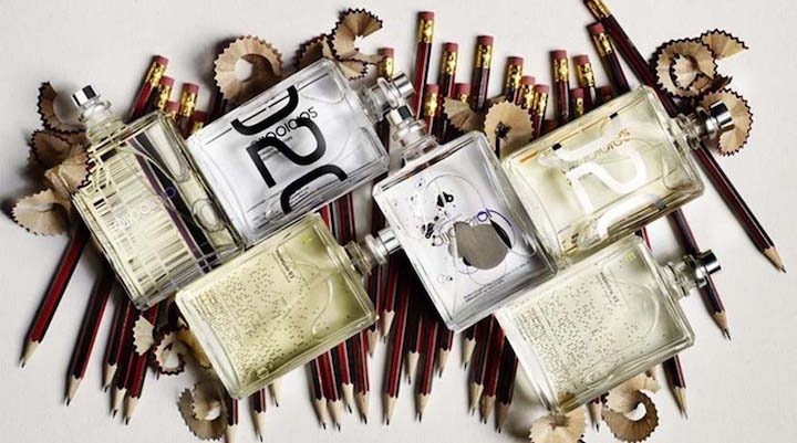 Escentric Molecules perfume bottles on top of pencils