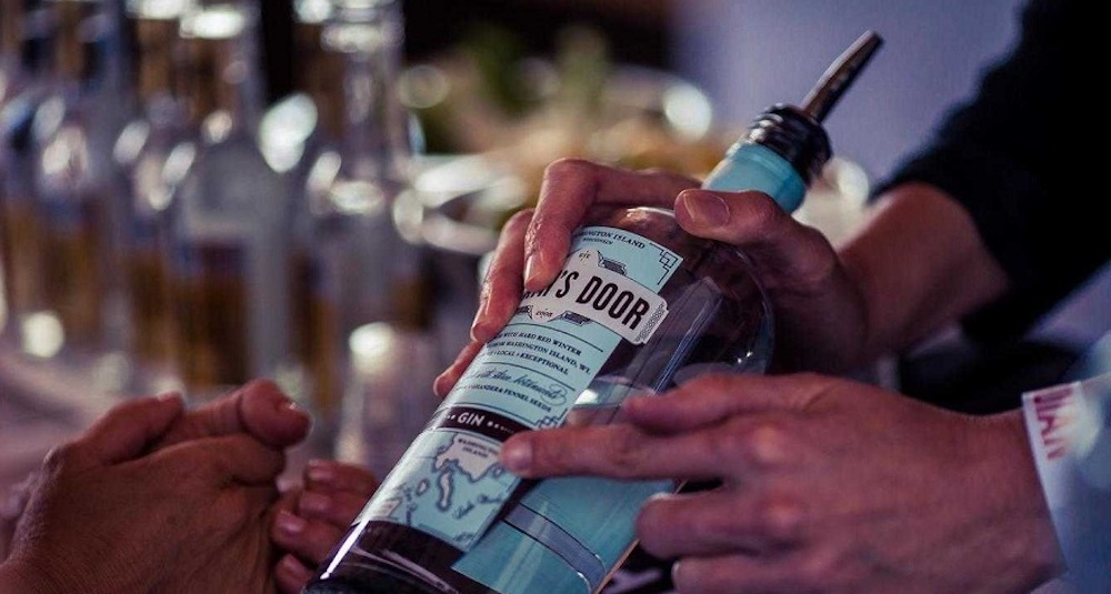man pointing at gin bottle label