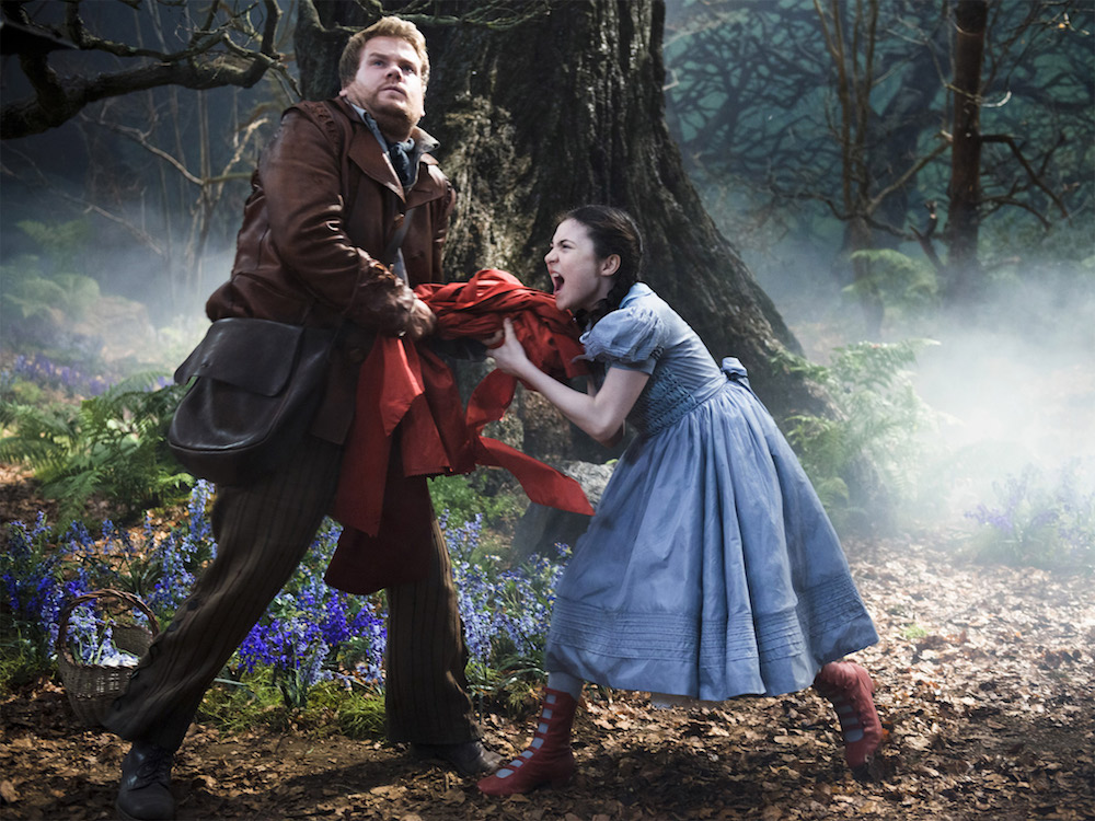 into the woods james Corden stealing red cape off little girl