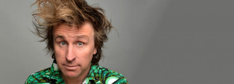milton jones messy hair green shirt
