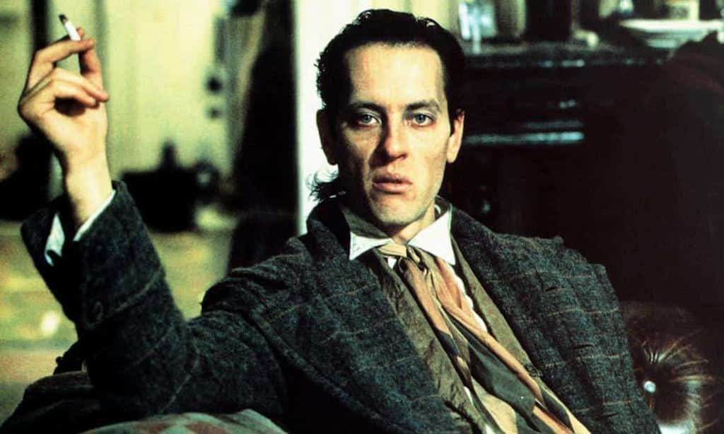 richard e grant staring hautily and drunk at the camera in withnail and I