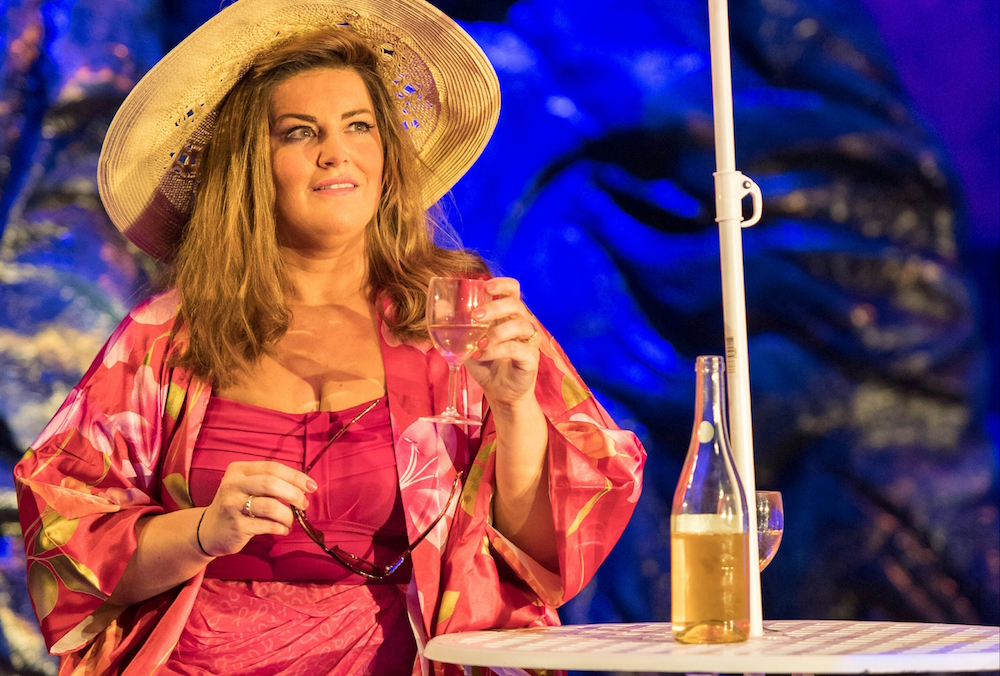 shirley valentine in sun hat pink swimming costume