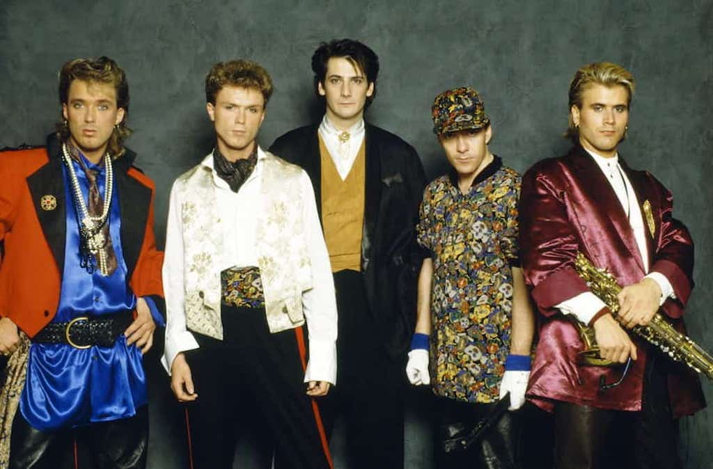 spandau ballet new romantic pop band wearing shiny silk shirts and staring into the camera