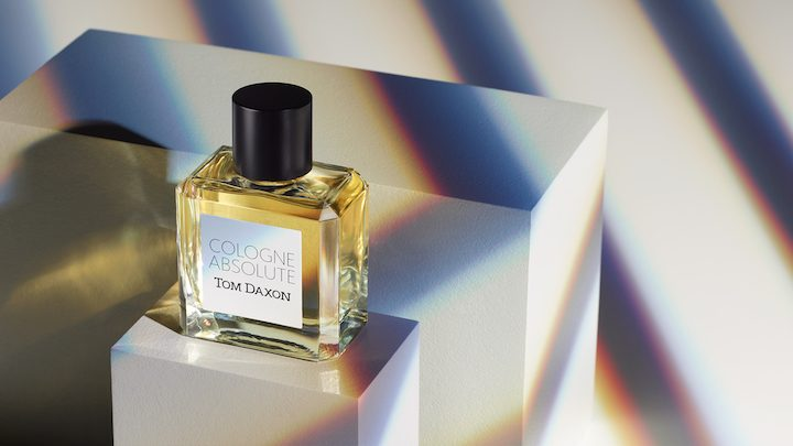 Tom Daxon fragrance bottle on white block