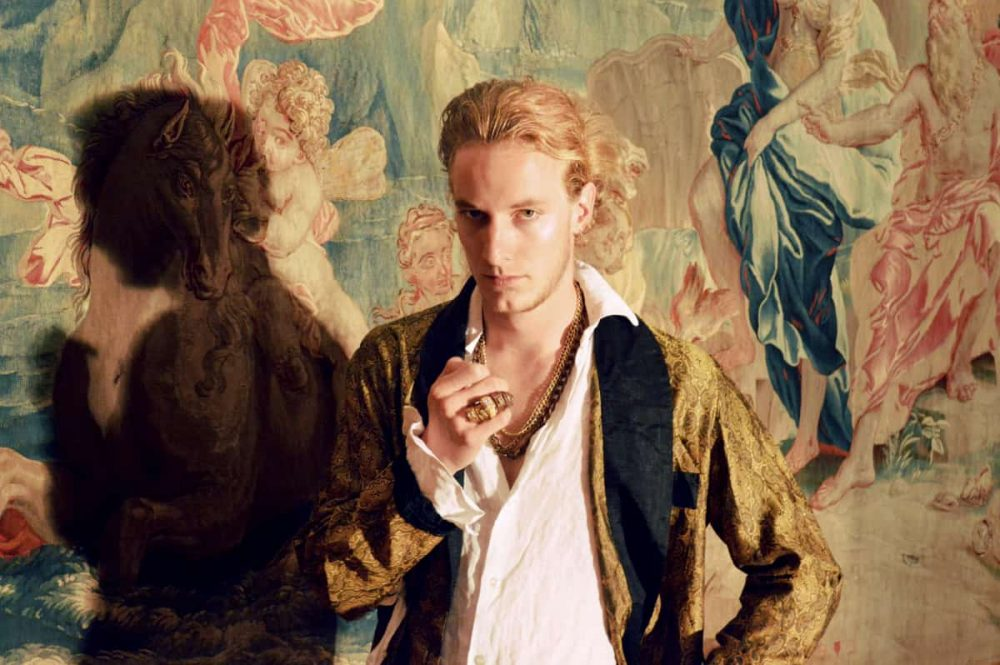 blonde renaissance man in velvet jacket cherub wallpaper