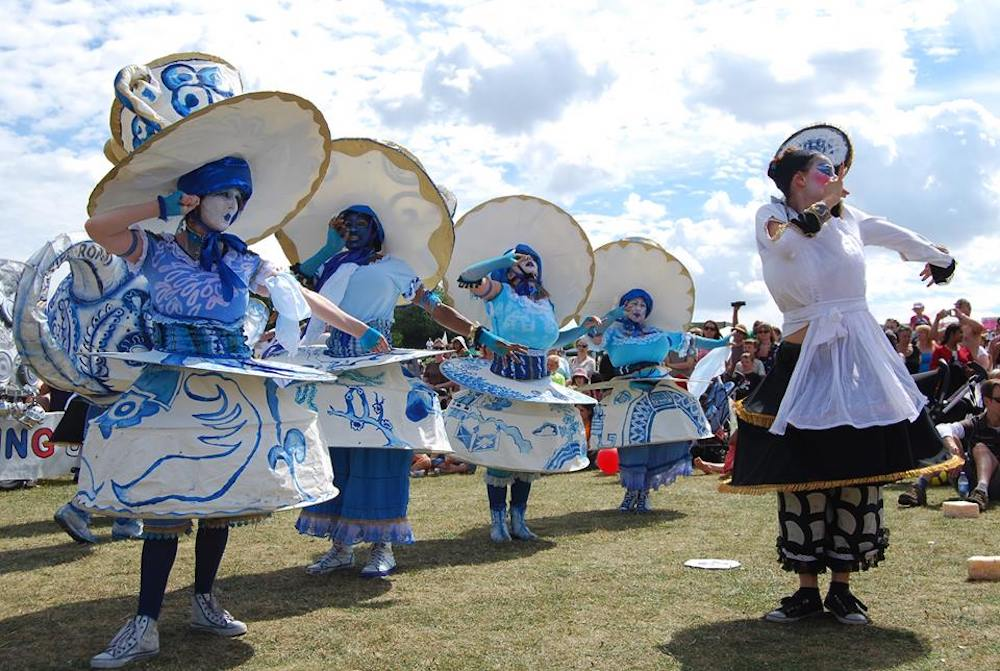 woman dressed as blue teacups dancing