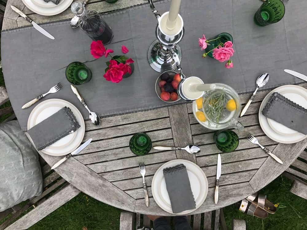 aerial shot on set garden table grey runner plates cutlery