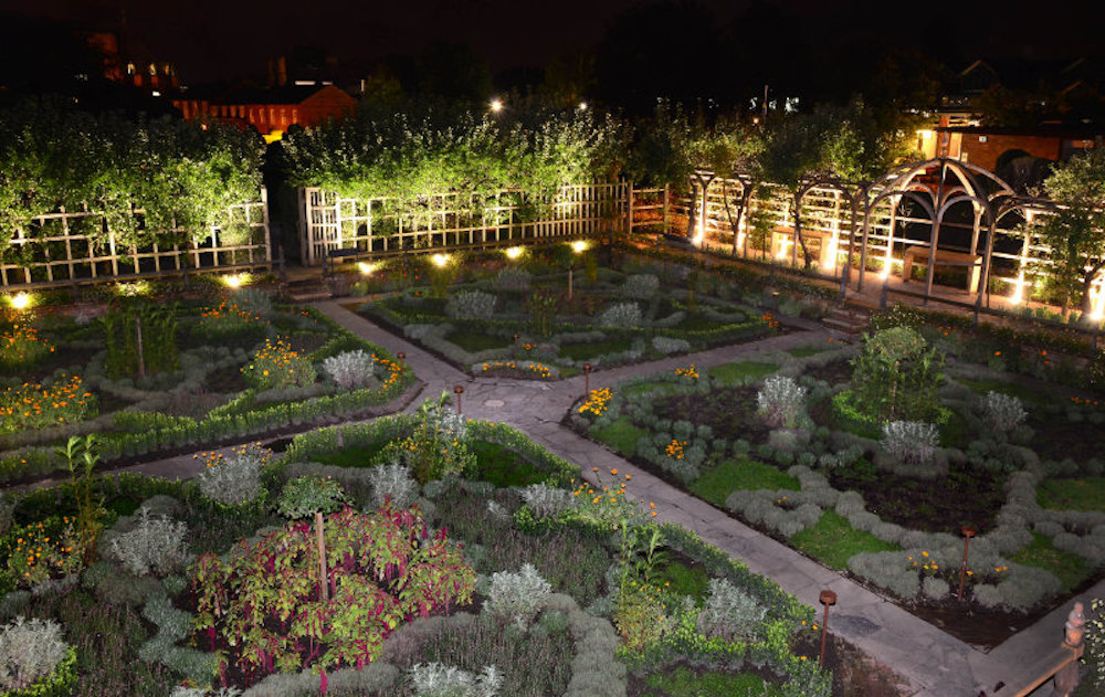 landscape garden split into quarters surrounded by fence at night
