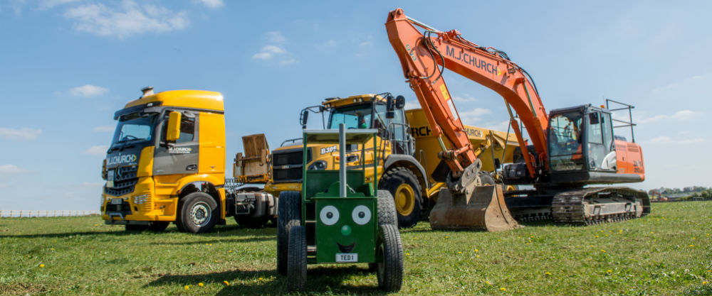 tractor ted diggers anf dumpers on grass hill