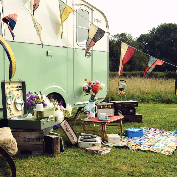 green caravan bunting vintage accessories on grass