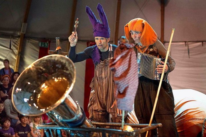 circus performers clowns dressed as animals playing instruments