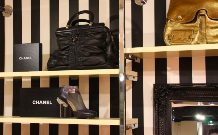 black and white stripy wall shelves Chanel handbags and shoes