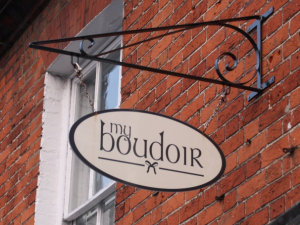 red brick wall my boudoir white sign