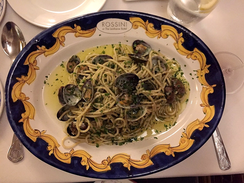 patterned bowl containing linguine with mussels