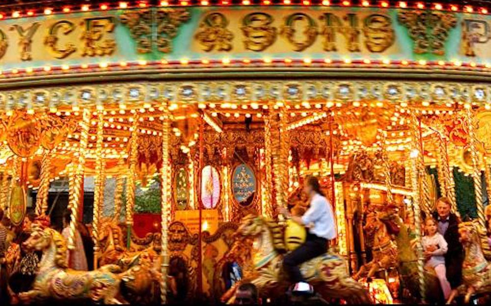 merry go round traditional horses spinning